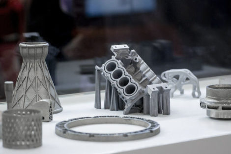 Man_is_holding_object_printed_on_metal_3d_printer._Object_printed_in_laser_sintering_machine._Modern_3D_printer_printing_from_metal_powder._Progressive_additive_DMLS,_SLM,_SLS_3d_printing_technology