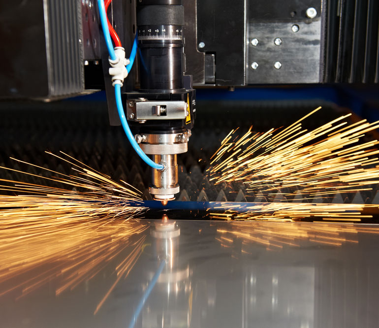 Industrial_Laser_cutting_processing_manufacture_technology_of_flat_sheet_metal_steel_material_with_sparks